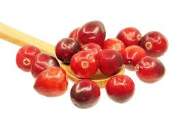 Cranberries in spoon